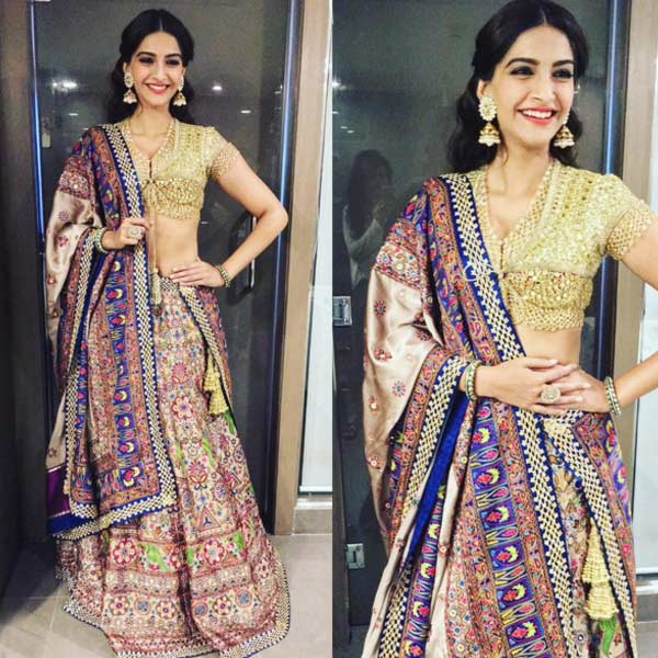 How can she pull off such decadent outfits like this designers Abu Jani and Sandeep Khosla lehenga like it is no big deal...!